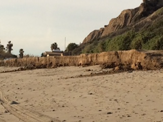 "Beach-front erosion from the heavy ""King Tides"" that hammered the San Onofre shoreline in January of 2016. The current plan buries nuclear waste in casks located just 150 feet from the beach. The bottom of each cask will rest several inches above the water table. At this time, there is no plan to remove the casks, until the Year 2049."